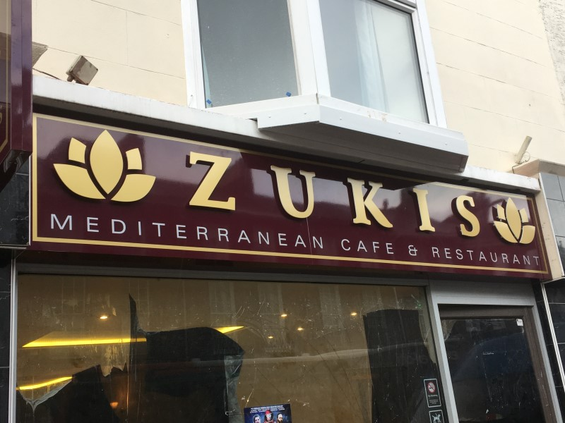 sign-zukis-front